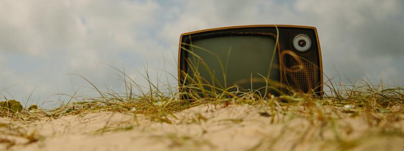 Old TV in field